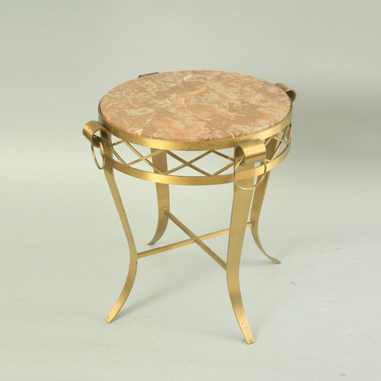 High quality, late 20th century, French neoclassical style bronze and round marble top occasional bouillotte centre table. Item features a heavy solid bronze frame with four drop ring accents, four shapely saber legs, cross stretcher supported base,