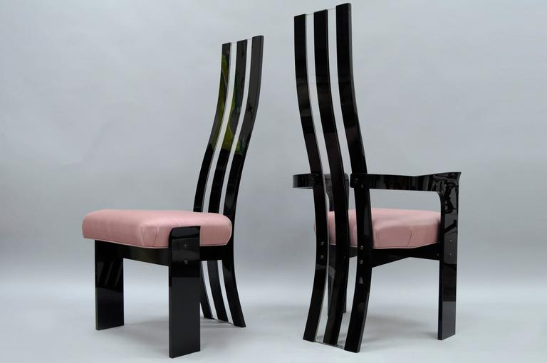 Set of 6 Mid Century Modern Black and Clear Lucite Sculptural Dining Chairs by Hill Manufacturing. Set includes two armchairs, four side chairs, black and clear tall sculpted backs, thick lucite construction, pink upholstered seats, sleek shapely