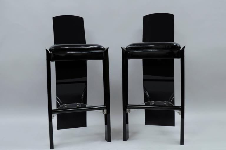 Pair of Vintage Mid Century Modern Black Lucite Acrylic Sculptural Bar Stools by Hill Manufacturing in the manner of Charles Hollis Jones. Item features thick lucite construction, clear lucite stretcher supports, black metal footrests, black patent