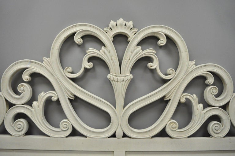 Vintage French Provincial / Rococo carved wood king-size bed headboard. Item features fancy scroll work, white finish, solid wood construction, and great style and form, circa mid-20th century. Measurements: 54