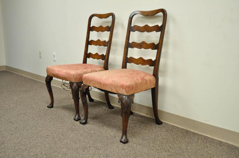Remarkable pair of hand carved walnut, 18th Century, English Ribbon Back Side Chairs. The chairs feature hand carved and beveled edge rungs, shell carved knees, shapely cabriole legs, trifid footed, and a great overall patina to the wood. The
