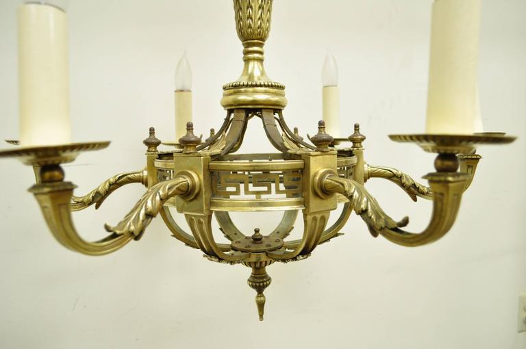 Early 20th Century French Neoclassical Style Bronze Greek Key Chandelier In Excellent Condition For Sale In Philadelphia, PA