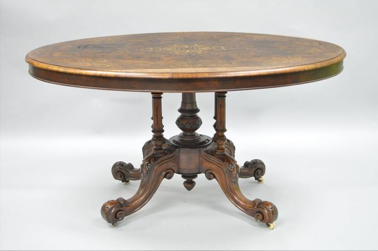 High Victorian 19th Century Victorian Carved Burl Walnut Tilt-Top Marquetry Inlaid Center Table For Sale