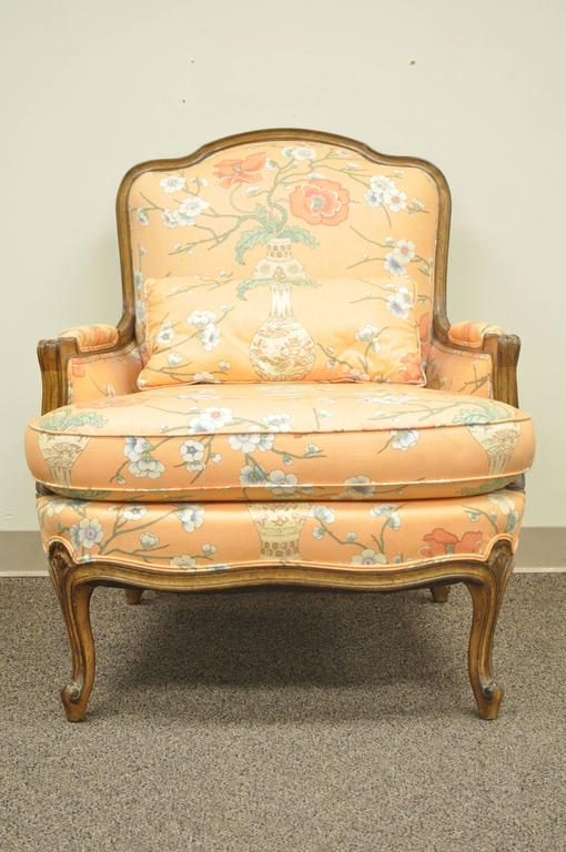 Quality vintage 1950s, French country Louis XV style shell carved bergere armchair and matching curved ottoman. Lounge chair and stool features shapely cabriole legs, shell carved accents and Classic and elegant form. Ottoman measures 19