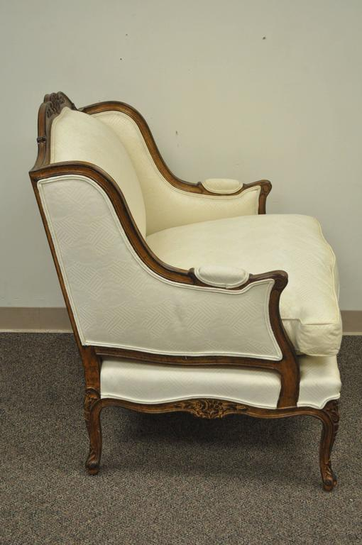 Mid-20th Century Vintage Wide Frame French Country Louis XV Style Floral Carved Bergere Arm Chair For Sale