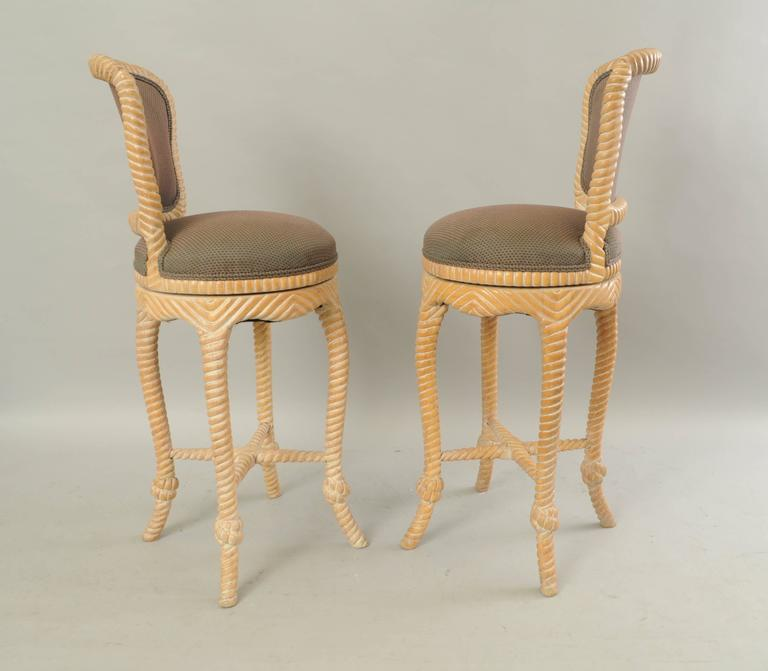 Pair of Vintage Italian Carved Wood Rope and Tassel Swivel Bar Stools Chairs In Good Condition For Sale In Philadelphia, PA