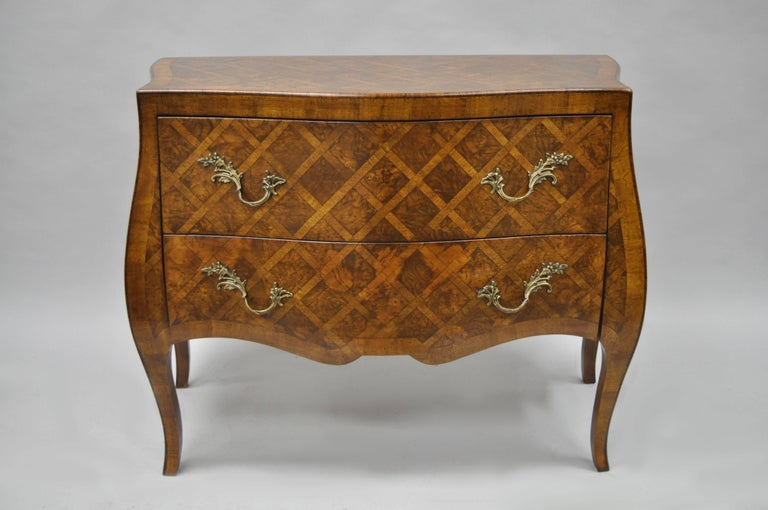 Vintage Italian Parquetry Inlaid Bombe Commode in the French Louis XV Style. Item features two drawers, brass hardware, shapely cabriole legs, and stunning parquetry inlay. Marked Italy