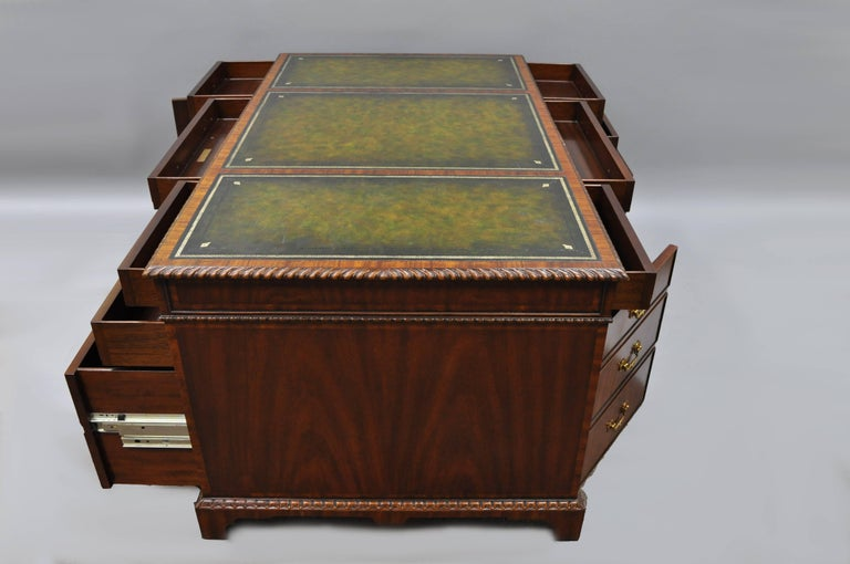 Stately Mahogany 3 part executive partners desk with green tooled leather top by Maitland-Smith with working drawers / doors on both sides. Item features five drawers and one-door on each side, green tooled leather top, carved rope edge, solid brass