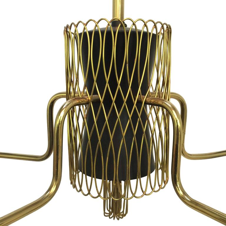 Such an incredible chandelier by Finnish Master Paavo Tynell for Idman.   This example has everything you are looking for in a Tynell fixture. Solid brass construction, white glass shades, dazzling brass lattice and flourishes....  Perfect scale