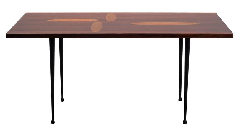 A very exciting coffee table in rare woods by Tapio Wirkkala for Asko, circa 1958.  This example has a taller base than most which is very well suited for the display of small objects.   Four beautifully created leaf motifs inlaid into the table