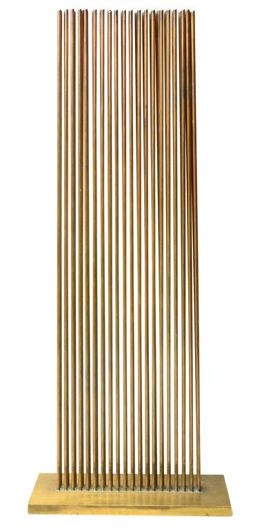 Such a nice example of a Harry Bertoia Sonambient.  This piece has 60 rods silvered in three rows in Beryllium on a thick brass base.   Incredibly bright and loud sounds that are unexpected from such a tight grouping .   Long lasting sound.