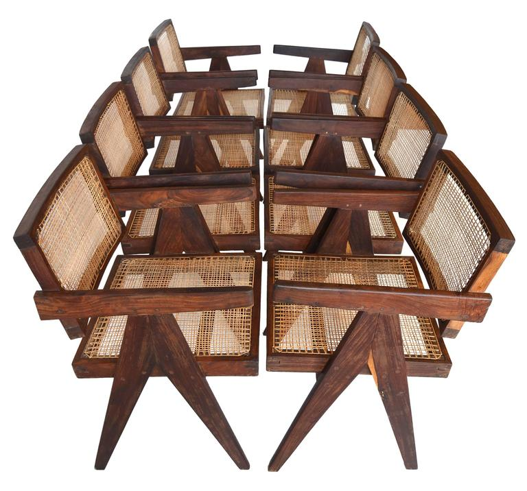 A truly rare set of eight Sissoo rosewood armchairs by Pierre Jeannette for the Chandigarh Project. This set is in my opinion one of the finest available. A true matching set as the chairs were from the same building and made by the same craftsman