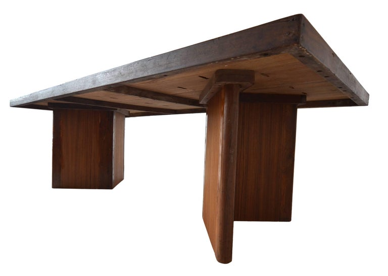 An incredible example of a very rare large library table by Pierre Jeanneret for the Chandigarh Project, circa 1955.