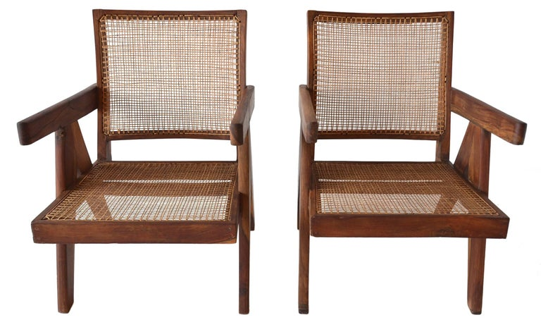 An exceptional correct pair of low lounge chairs by Pierre Jeanneret of the Chandigarh project, circa 1955.  These chairs are in exceptional condition and are created from solid Indian Rosewood.   A fine vintage pair. Renovated sympathetically
