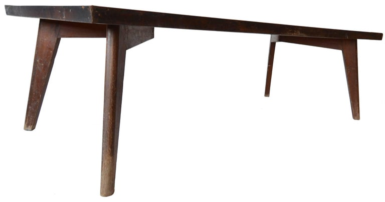 This is a very beautiful and rather rare large dining or conference table designed by Pierre Jeanneret for the Chandigarh Project.