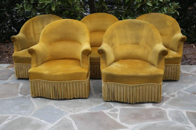 Set of five Antique French chartreuse velvet salon chairs with original upholstery and fringe detail. Velvet shows its age but this only adds to the ambiance of the set. Priced and sold individually.