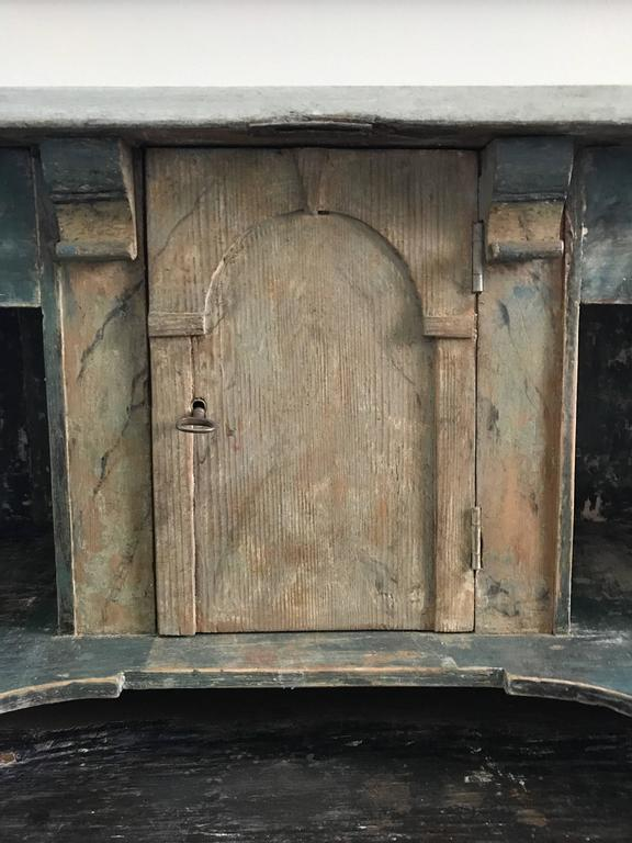 18th century Swedish drop front secretary with faux marble painted interior. Beautiful original painted finish. Eight interior compartments over two lower drawers. Original hardware. Interior cabinet has a beautifully painted faux marble treatment.