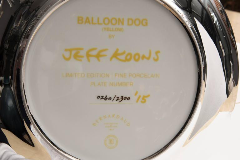 Jeff Koons balloon dog (Yellow), 2015,  porcelain, signed and numbered on the back: 240/2300, Bernardaud edition, 2015, USA. Measures: Height 27 cm, diameter 27 cm. Certificate of authenticity, original box.