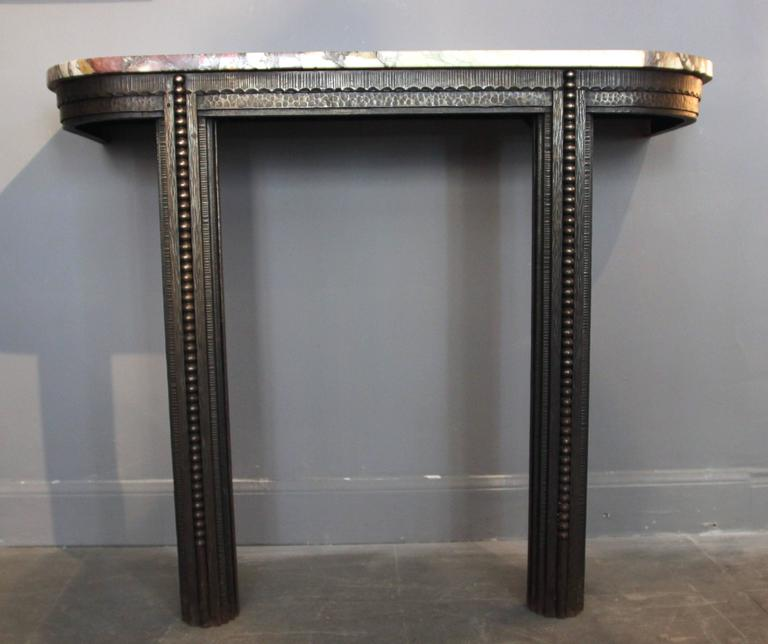 Style Edgar Brandt, console, iron sculpted and marble top, circa 1925, France. Measures: Height 91 cm, width 110 cm, depth 40 cm, Top thickness: 2 cm.