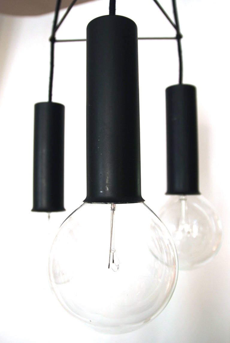 Gino Sarfatti, chandelier with three lights, Lacquered aluminium, iron and screw bulbs, Production Arredoluce (label), circa 1950, Italy. Measures: Height 110 cm, diameter 22 cm.