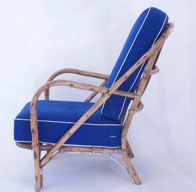 Audoux-Minet, suite of four armchairs, rattan, logo of the artist, circa 1960, France. Measure: Height 88 cm, seat height 40 cm, width 68 cm, depth 50 cm.