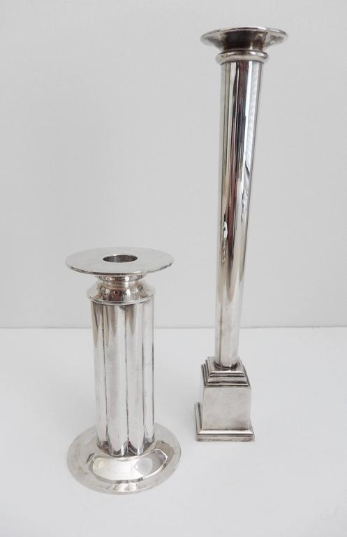 Two impressive silver plated candlesticks designed by the postmodernist architect Robert A. M. Stern (b. 1939) for Swid Powell. The columnar designs reflect Stern's interest in classical modernism. Both signed with impressed signature and marked