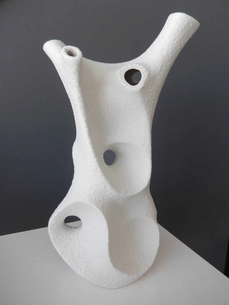 In 1955 two brothers, Peter and Klaus Muller opened a small porcelain factory in Germany and created some of the most innovative, modern pieces from the postwar period. This porcelain vase is an extraordinary example of their introduction of