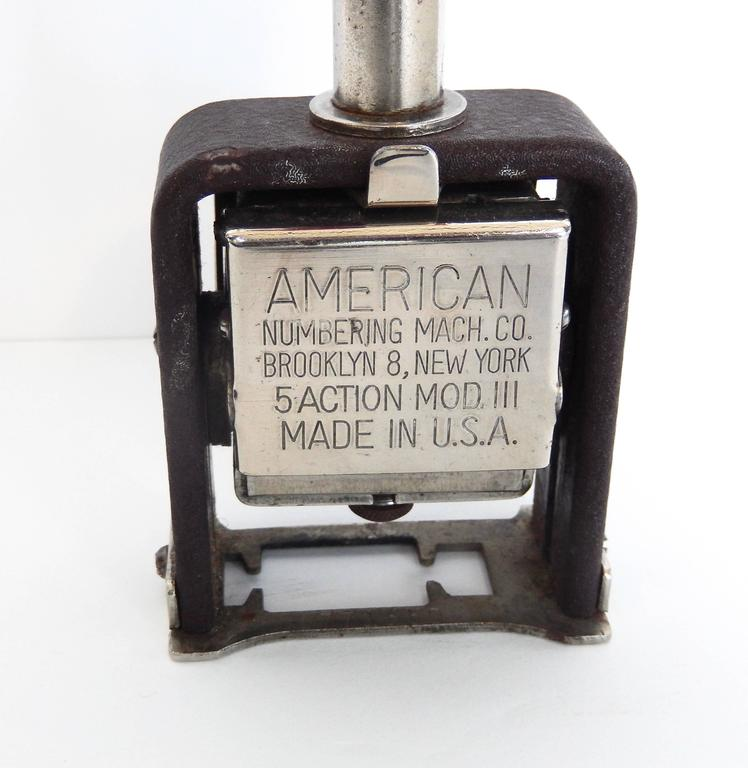 This vintage numbering stamp is an interesting example of Art Deco design in commercial products. A nostalgic reminder of life before computers. Made by the American Numbering Machine Company in Brooklyn.