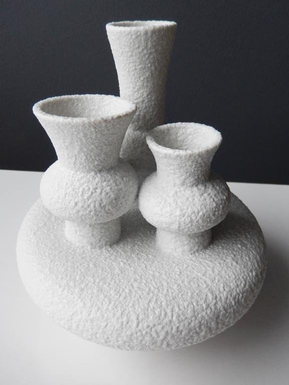 A sculptural Sgrafo Modern Korallenform vase with modernistic forms atop a circular, pod-like base. The unusual design recalls Gaudi's idiosyncratic forms. A bold, unique example of postwar German ceramics. Signed and numbered.