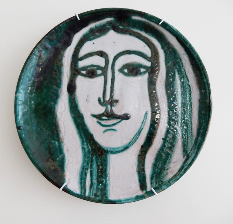 A rare portrait plate by the French potter Robert Picault (1919-2000). A compelling ceramic work signed and dated 1950. An important addition to a collection of Mid-Century Modern French pottery.