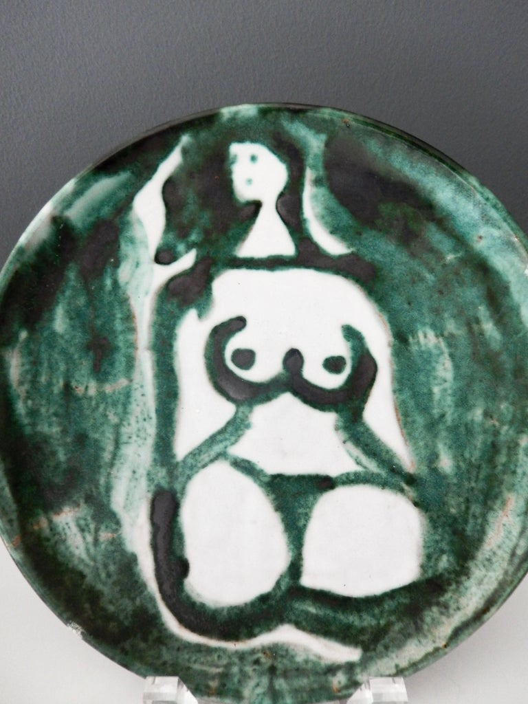 A rare ceramic plate of a female nude by the French potter Robert Picault (1919-2000). Signed and dated by the artist. A compelling and significant addition to a collection of Mid-Century Modern French pottery.