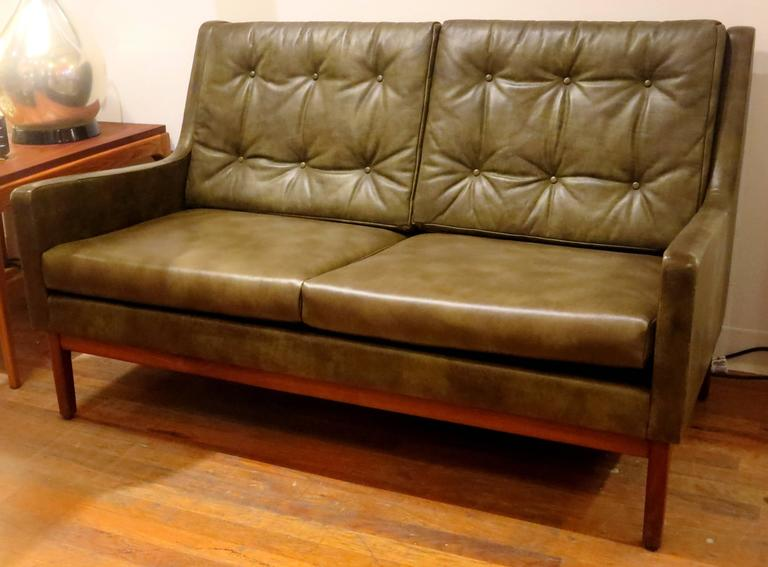 A Very Rare 1950s American Modern Loveseat By Gunlocke, In Olive Green  Leather, With
