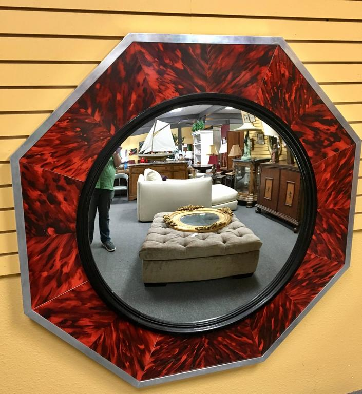 Impressive large mirror with concave center in a faux tortoise shell decorative frame with polished aluminum edge by Anthony Redmile London (stamped on the top) Purchased in England in the 1970s.