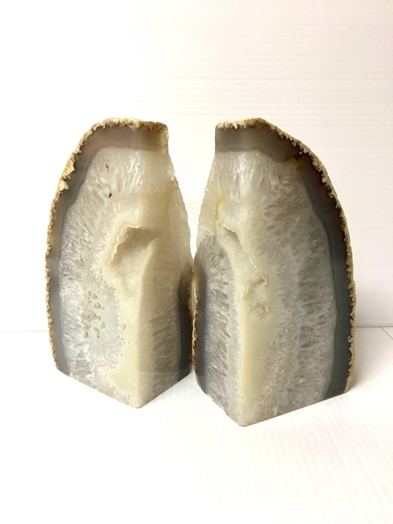 Versatile set of geode bookends, circa 1990s. Geode bookends can sit in two positions exposing different color options as show in images, beautiful white color.
