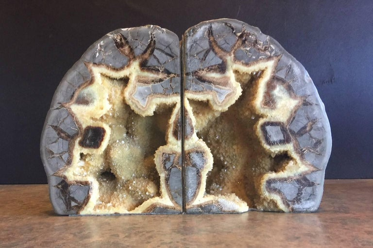 Gorgeous pair of very large geode bookends, circa 1960s. Bookends can be set in two positions (see pictures), exposing different color options and textures. Truly a unique gift!