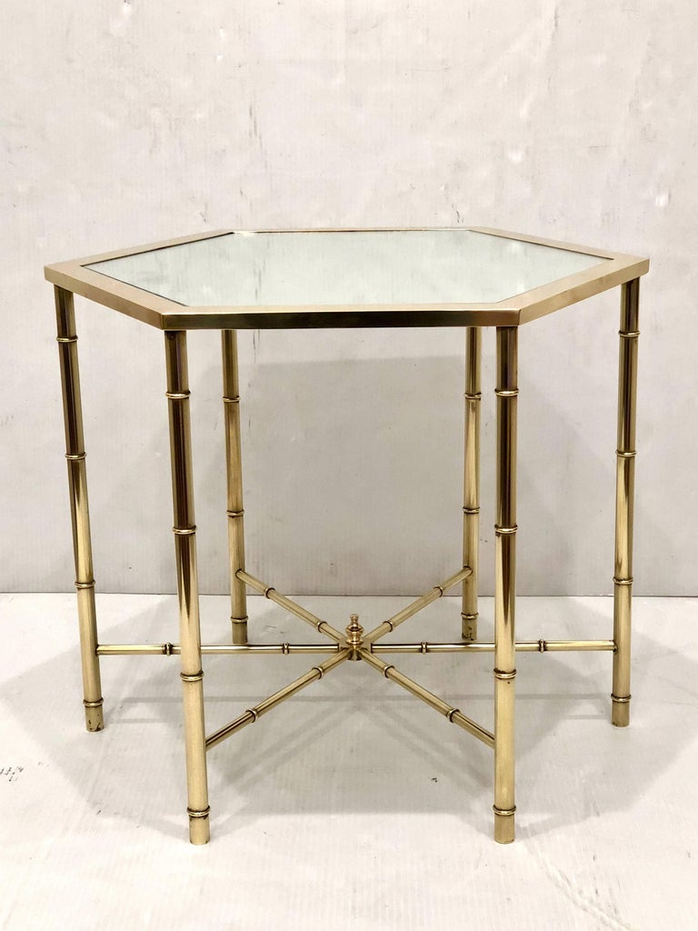 Elegant pair of freshly polished brass hexagonal cocktail of end tables, with new mirrored tops striking, versatile and unique.