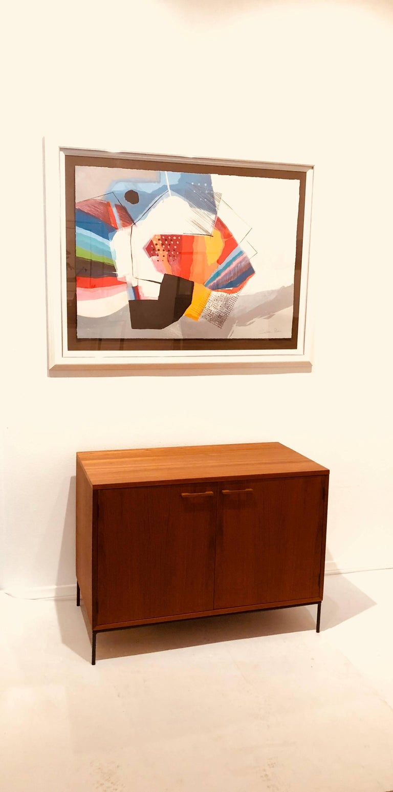 Simple elegant double-door mini stereo cabinet, in teak freshly refinished the top lifts for playing records and has a shelf and good storage.