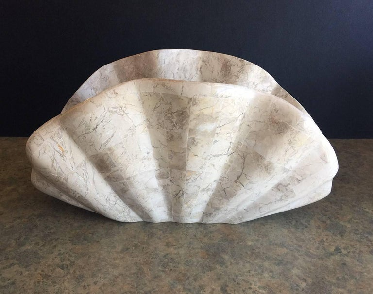 American Tessellated Stone Clam Shell Shaped Magazine Rack by Marquis of Beverly Hills For Sale