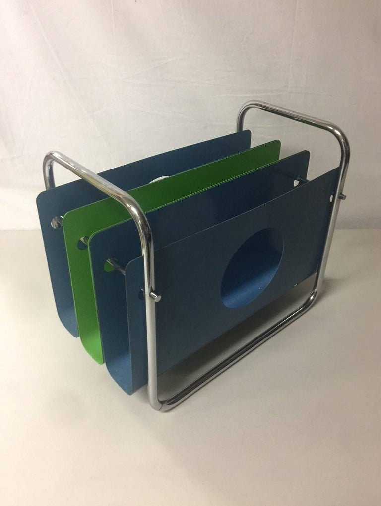 A rare and unique painted sheet metal and chrome magazine rack by Peter Pepper Products, circa 1970s. The piece is in good vintage condition with some fading, marks and chips (please see pictures). This is a very rare piece as I was not able to