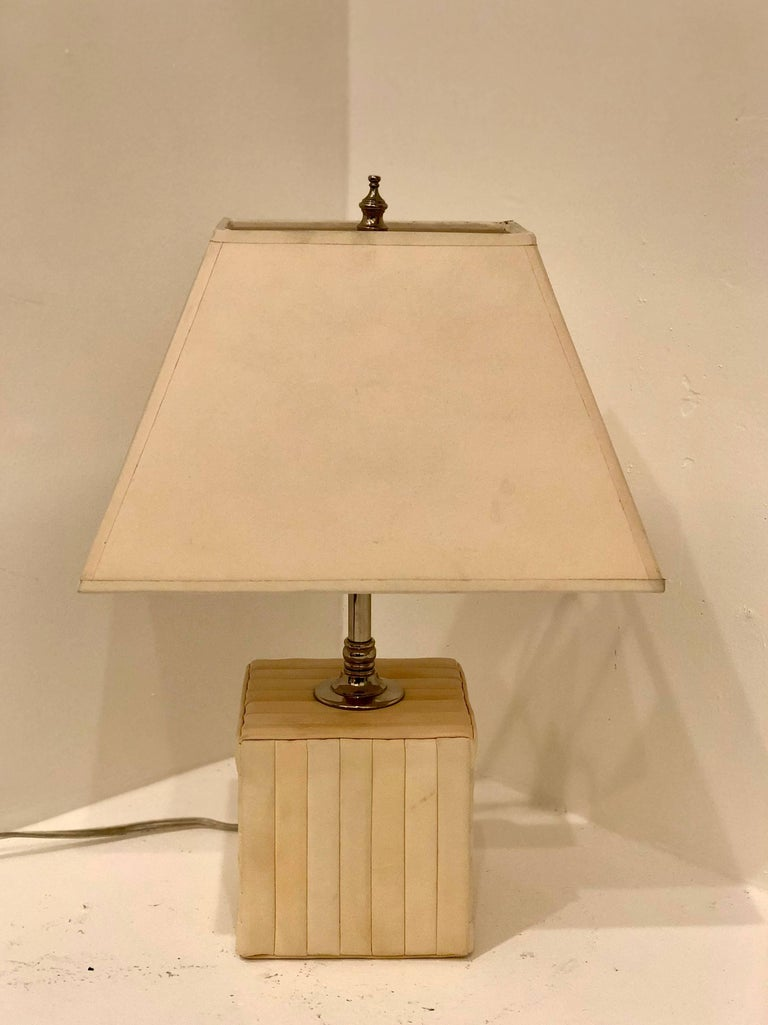 Beautiful elegant goat skin wrapped cube table lamp. Freshly rewired in excellent condition with normal wear due to age new sockets the lamp shade its original, in clean condition with normal wear. Measure: The base its 5