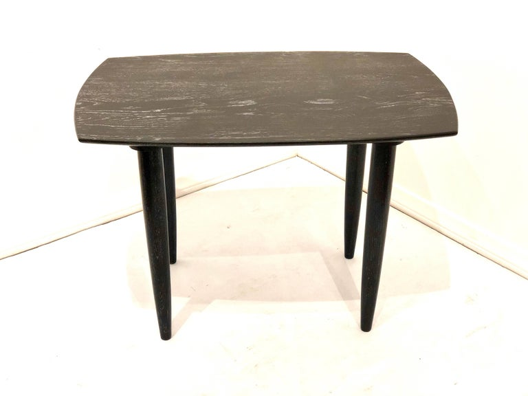 Simple elegant end table, circa 1950s by Ace of California furniture freshly refinished in a cerused oak finish, with tapered legs that can be removed for easy shipping, solid and sturdy in great condition. Rounded edge and bevelled edge great