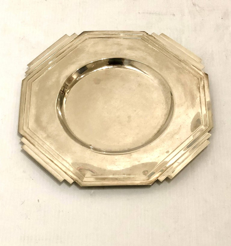 Beautiful and rare Art Deco charger plates signed. Silver plated finish great design light tarnish that can be polished.