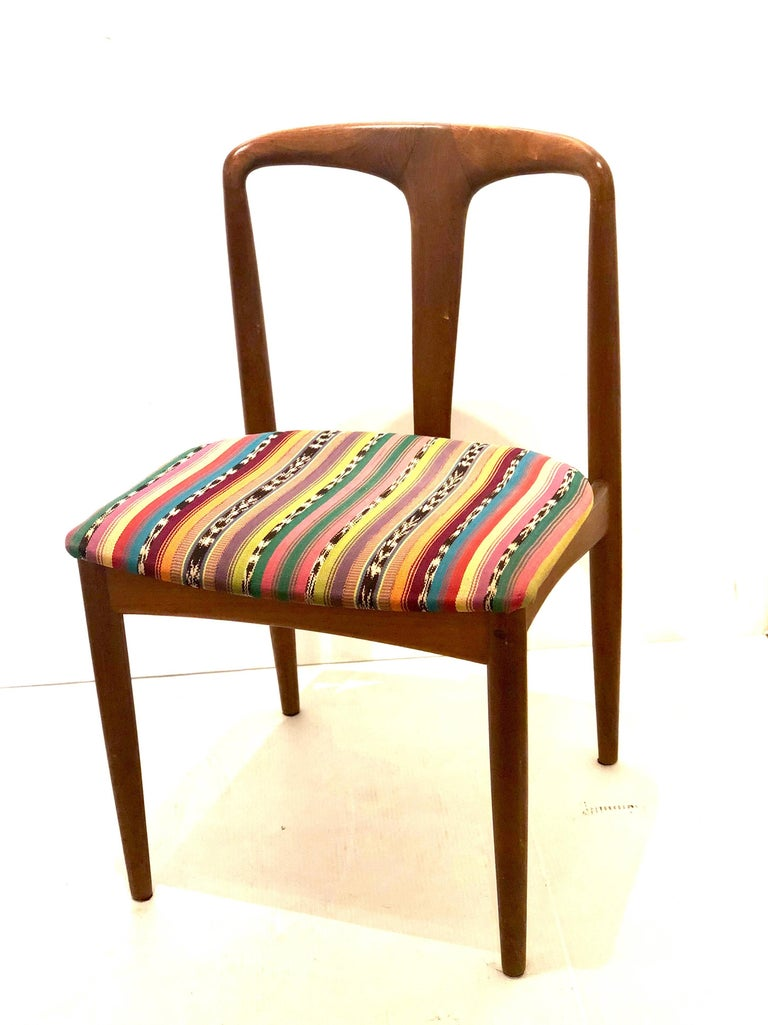 Beautiful solid sculpted teak chair designed by Johannes Andersen for Uldum Mobelfabrik, circa 1950's, nice and solid construction beautiful lines freshly refinished and recover in Mexican textile.