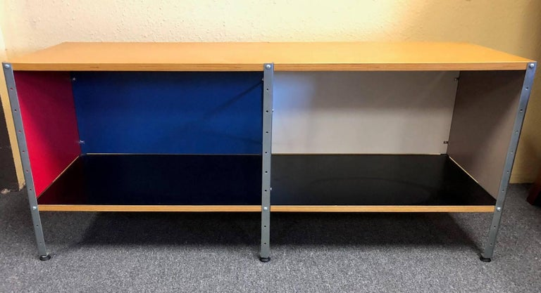 Storage unit 100 2 x 1 bookcase designed by Charles & Ray Eames for Herman Miller, circa 2000s. The piece is in very good condition.  Eames storage units are emblematic of the grace and whimsy Charles and Ray Eames used in designing home