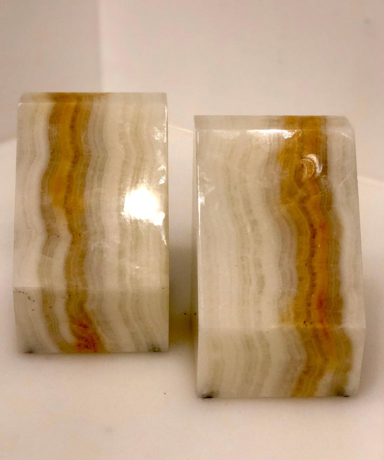 Substantial pair of solid onyx bookends, circa 1970s.