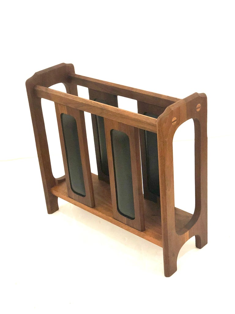 Beautiful and rare solid walnut magazine rack, we believe it was design by Arthur Umanoff, freshly refinished, California design. Incredible craftsmanship and detail with black Naugahyde decorative inserts.