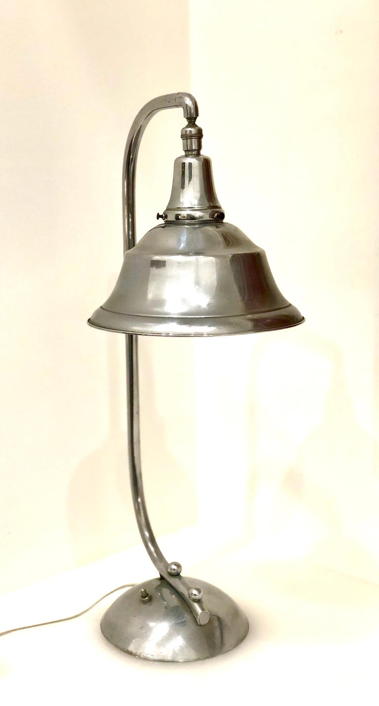 Beautiful and rare Art Deco table lamp, circa 1940s rewired the shade moves side to side and up and down, the chrome its in very clean condition with natural wear due to age, no rust.