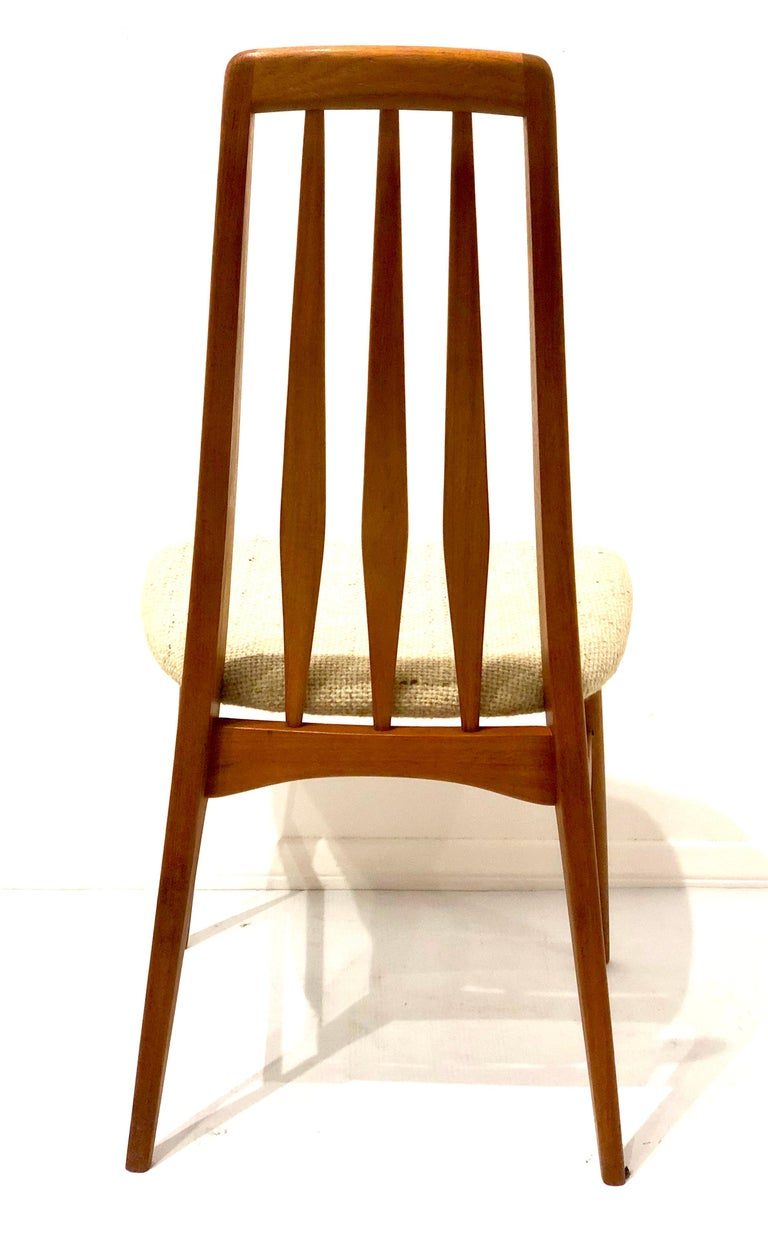 Elegant lines and beauty on this single tall back chair design by Niels Koefoed, famous Eva chair, solid teak solid and sturdy in its original fabric in an oatmeal color.