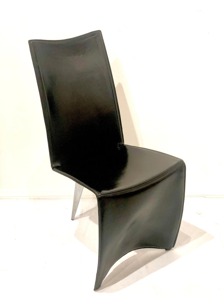 Elegant piece of art chair by Philippe Starck for Driade, circa 1987 in black leather , and polished aluminum back leg.