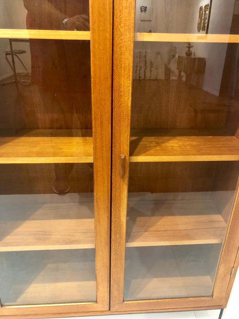 Danish Modern Teak Glass Bookcase by Dyrlund on Solid Iron Base In Excellent Condition For Sale In San Diego, CA